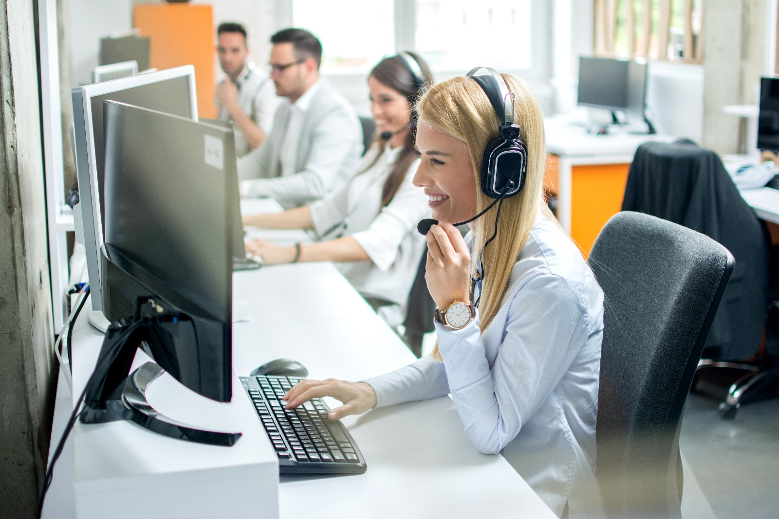 Woman with headset in a contact center