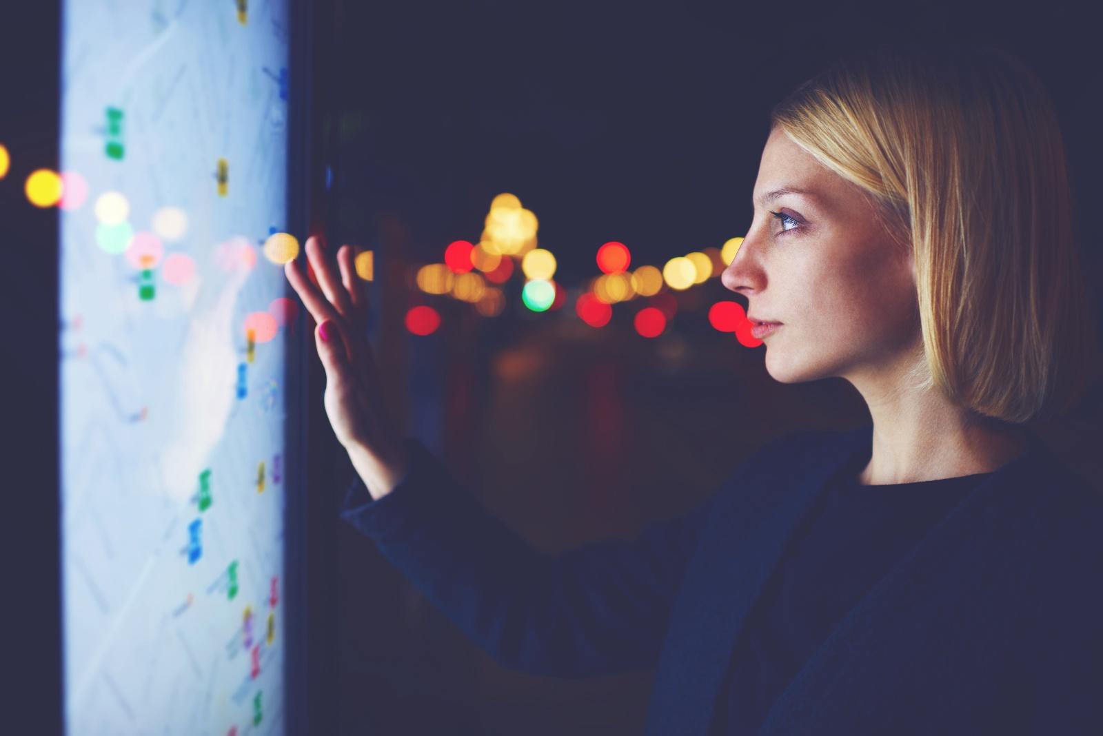 Woman using digital wayfinding