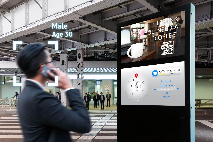 Man on phone looking at digital signage